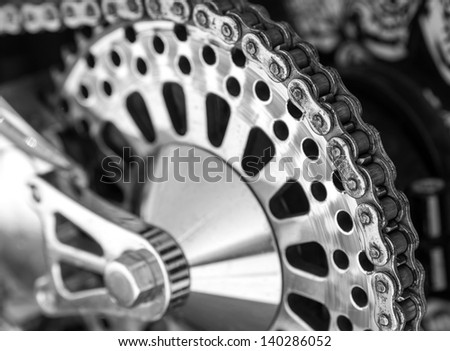 Detail of a motorcycle rear chain - stock photo