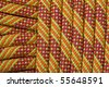 detail of a new orange, yellow, and red climbing rope - stock photo
