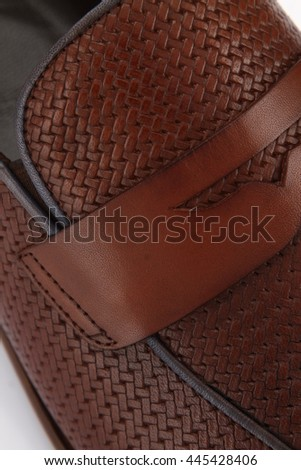 Detail of a pair of luxurious men's leather shoes. - stock photo