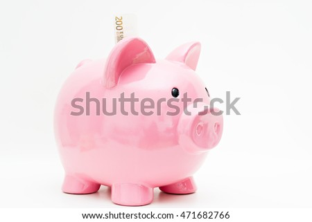 Detail of a piggy bank and several euro banknotes