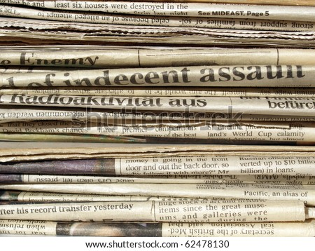 Detail of a pile of international newspapers - stock photo