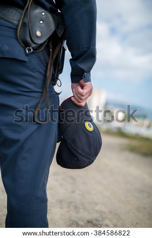 Detail of a police officer. Selective focus with shallow depth of field. - stock photo