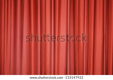 Detail of a red closed curtain in a theater - stock photo