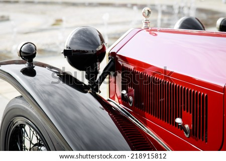 detail of a red vintage car - stock photo