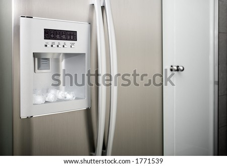 detail of a refrigerator with thread cubes - stock photo