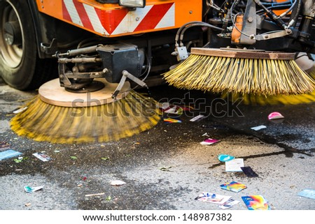 Detail of a road sweeper cleaning the streets after a parade - stock photo