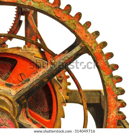 Detail of a rusty ancient church clock mechanism isolated on a white background - stock photo