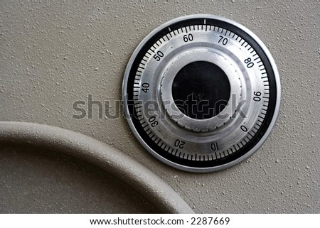detail of a safe and the combination dialer - stock photo