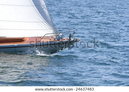 Detail of a sailing boat on a lake.
