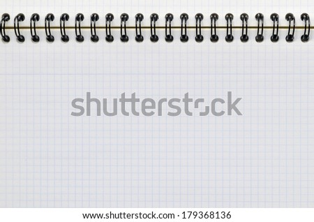 Detail of a sheet of graph paper in a notebook. Study and education concept - stock photo