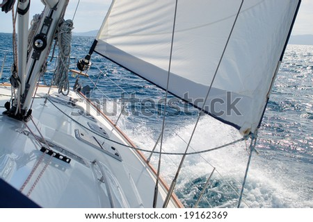 Detail of a ship sailing toward wind - stock photo