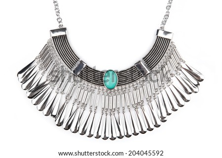 Detail of a silver statement necklace isolated on white - stock photo