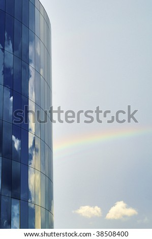 Detail of a skyscraper and rainbow