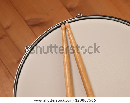 Detail of a snare drum with drum sticks