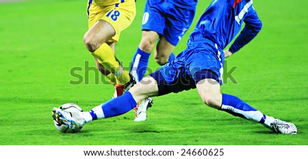 Detail of a soccer game with many players in action - stock photo