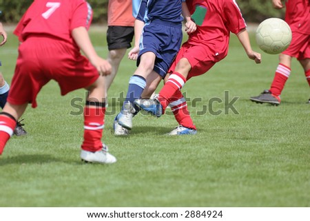 Detail of a soccer match of young boys. - stock photo