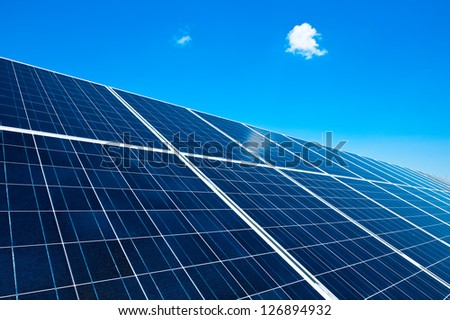 Detail of a Solar Panel with blue Sky - stock photo