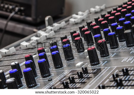 Detail of a soundboard mixer electronic device