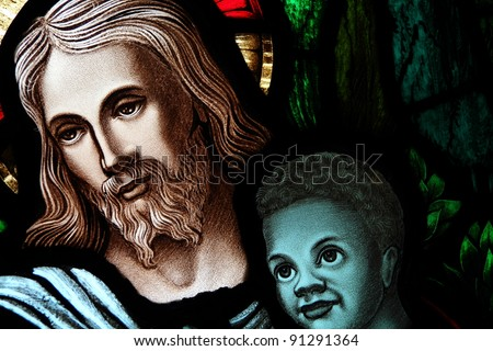 Detail of a stained glass window with Christ and child - stock photo