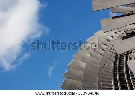 Detail of a steam turbine against the sky - stock photo