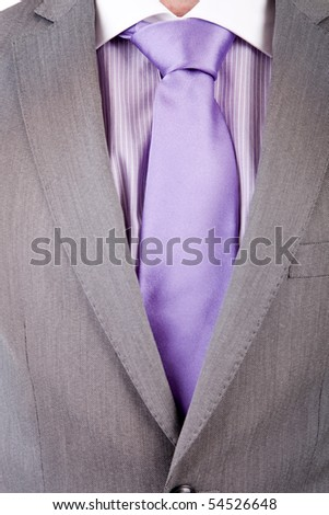 Detail of a suit and a tie - stock photo