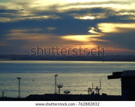 Detail of a Sunrise over the Tagus River in Lisbon, Portugal