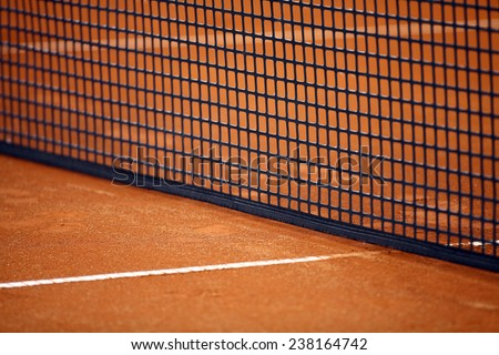 Detail of a tennis net on a clay court. - stock photo