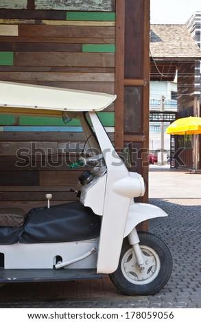 Detail of a three wheeled tuk tuk taxi in Thailand - stock photo