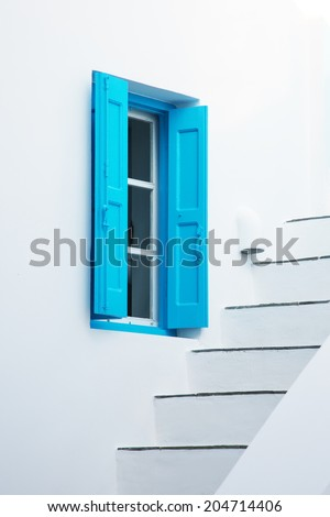 Detail of a typical Greece house with blue shuters - stock photo