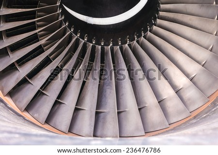 Detail of a used airplane jet turbine engine - stock photo