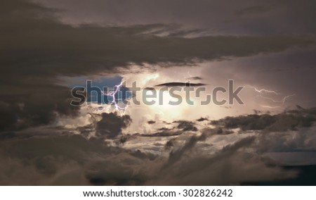 Detail of a very active thunderstorm, with a lightning, in Venezuela. Cumulonimbus cloud type - stock photo