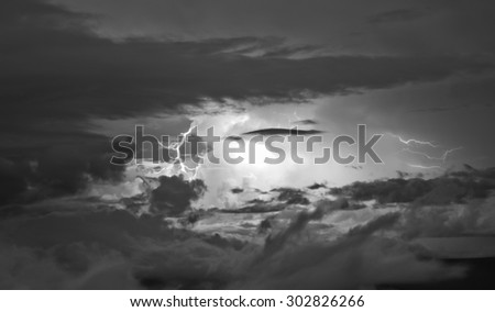 Detail of a very active thunderstorm, with a lightning, in Venezuela. Cumulonimbus cloud type. Black and White - stock photo