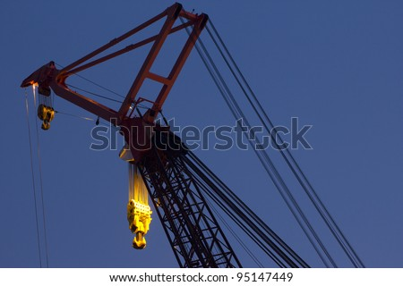 Detail of a very large crane situated on top of a deep-water construction vessel, designed for constructing offshore drilling-rigs as well as the installation of pipelines. Rotterdam, the Netherlands - stock photo