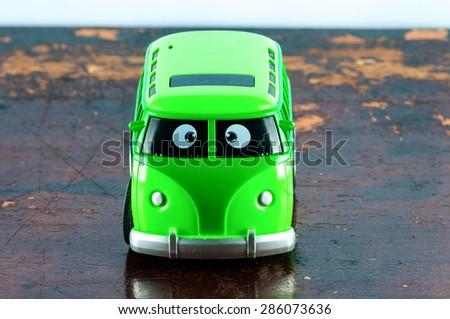 Detail of a Vintage Green Hippie Van Toy - stock photo