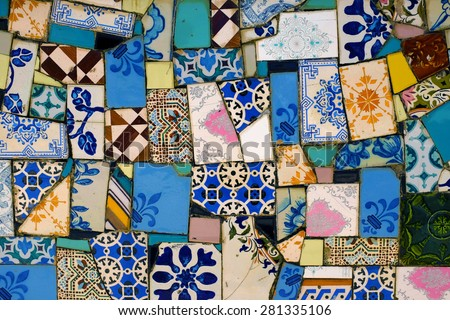 Detail of a wall covered with many assorted fragments of broken tiles - stock photo