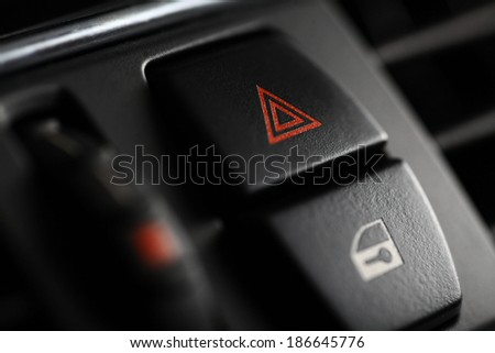Detail of a warning button in a car - stock photo
