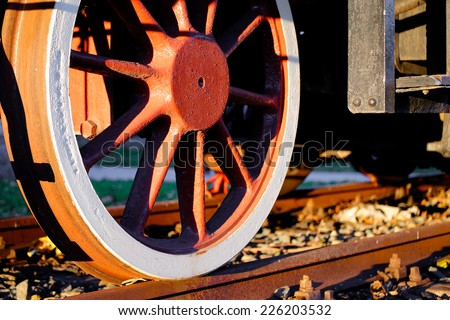 detail of a wheel of an old steam locomotive - stock photo