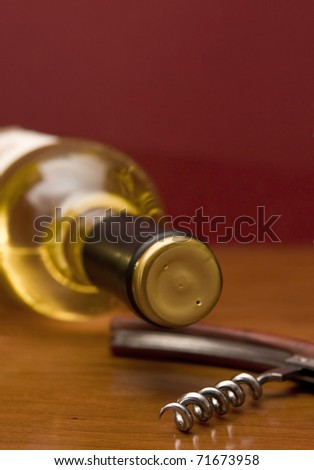 Detail of a white wine bottle with a corkscrew - Focus on the screw - stock photo