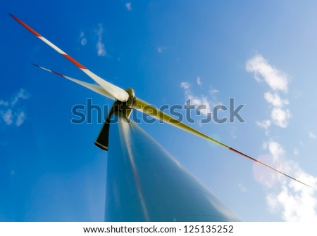 Detail of a wind energy wheel against the cloudy sky. - stock photo