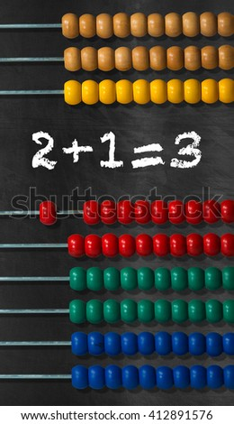Detail of a wooden and colorful abacus on a black background with a simple math addition - stock photo