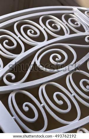 Detail of a wrought iron gate of a French mansion