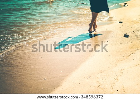 Detail of a young woman relaxing, walking by the beach. - stock photo