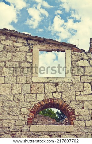 Detail of abandoned and ruined building without roof. Instagram-like retro effect added. - stock photo