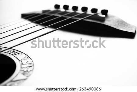 detail of acoustic guitar focus on bridge and strings, very shallow depth of field. Black & White - stock photo