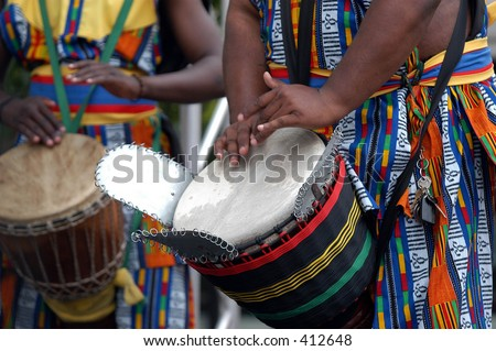 Detail of african drummer beating the drum - stock photo