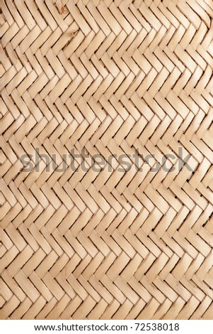 Detail of an African woven bag made to extract coconut juice. It is made from coconut palm leaves. - stock photo