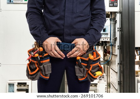 Detail of an electrician at work - stock photo