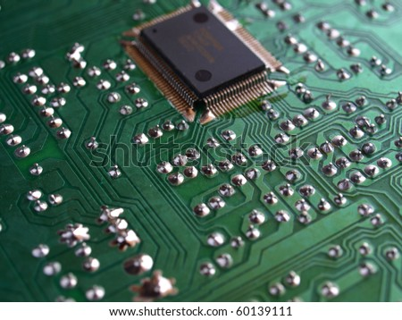 Detail of an electronic printed circuit board - stock photo