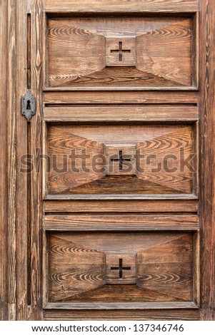 detail of an elegant and luxurious old wooden door - stock photo
