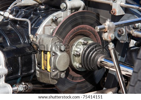 Detail of an engine and disc brakes of a race car - stock photo